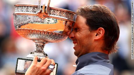 Rafael Nadal lifts the French Open trophy for the twelfth time after his four-set victory over Dominic Thiem in Paris.