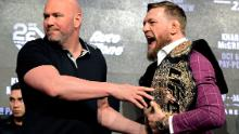 Conor McGregor is held by UFC President Dana White during the UFC 229 press conference at Radio City Music Hall on September 20, 2018 in New York City.
