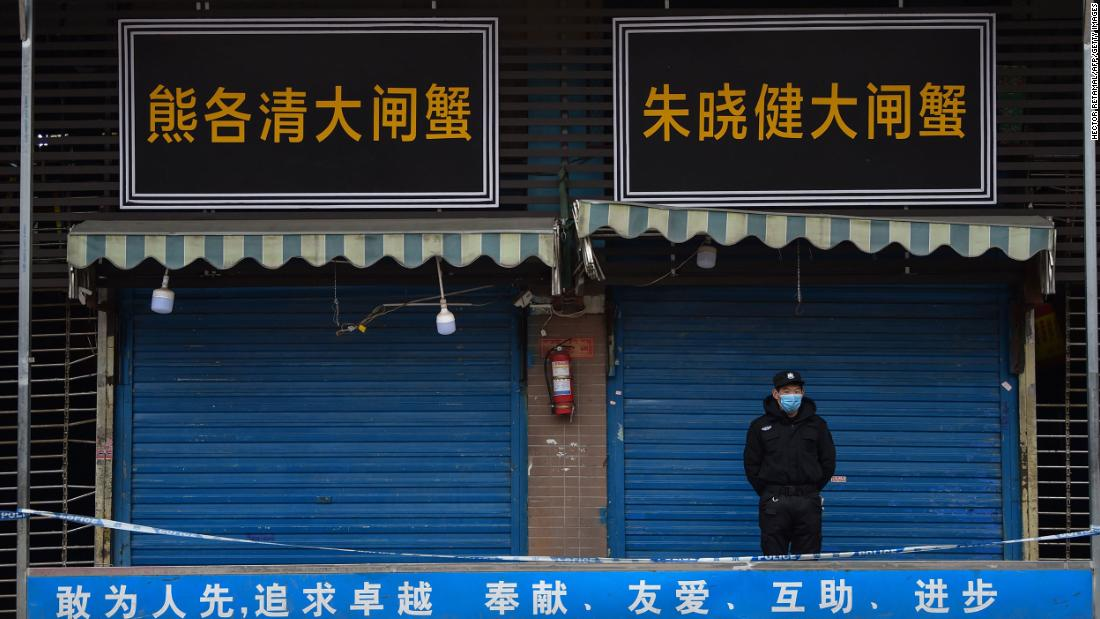 A security guard stands outside the Huanan Seafood Wholesale Market in Wuhan where the coronavirus was detected on January 24, 2020.