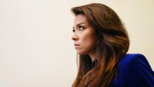 Chanel Rion listens as U.S. President Donald Trump speaks during a press conference in the White House. (Jim Lo Scalzo / EPA / Bloomberg via Getty Images)