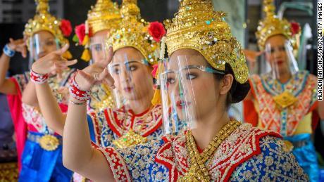 Traditional Thai dancers perform in a Bangkok shrine reopened last week.