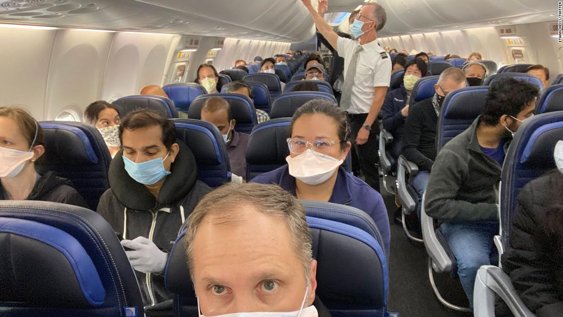 United Airlines said it would try to keep the central seats empty. This photo shows an almost complete flight