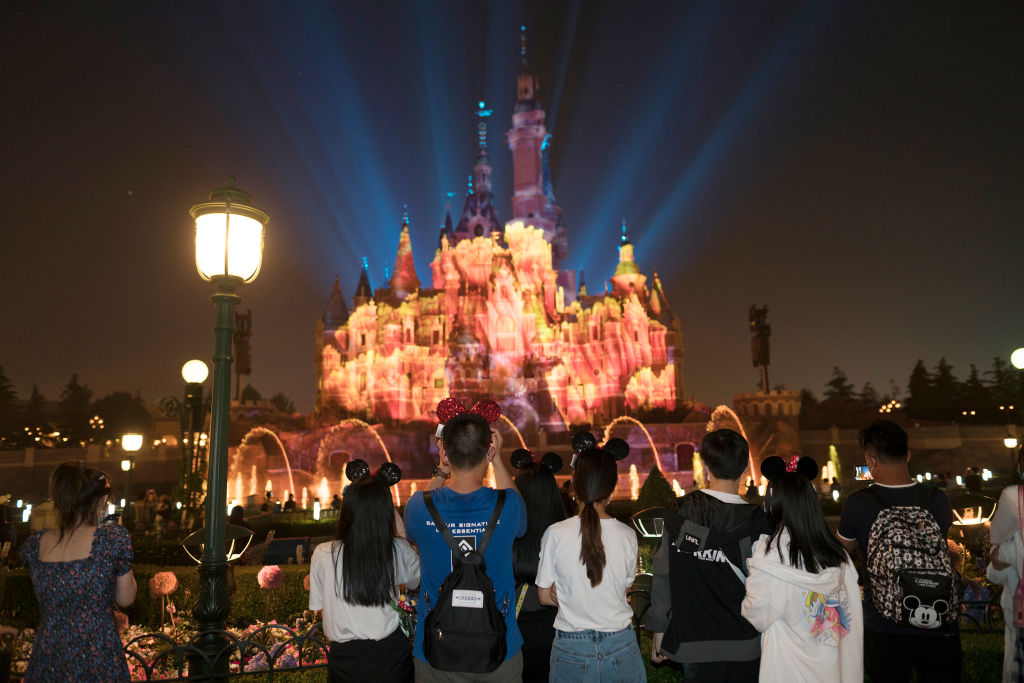 Tourists in Shanghai Disneyland on May 11th.