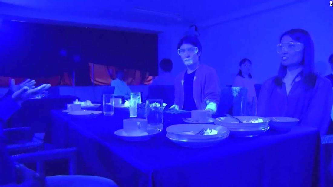 A black light experiment shows just how easily germs and viruses, can spread in restaurants and cruise ships.
