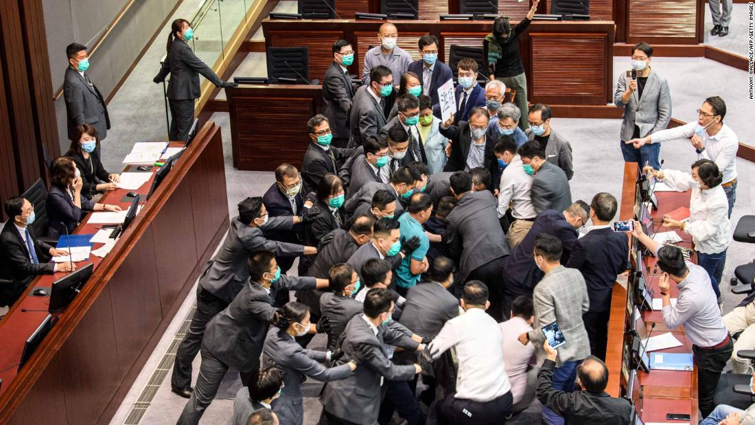 Lawmakers scuffle at the Legislative Council in Hong Kong on Monday.