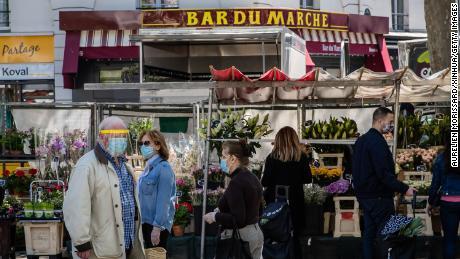 Shoppers at the Place de la Bastille market in Paris on May 17, 2020.