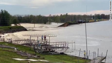 The dam failure came after days of intense rain.