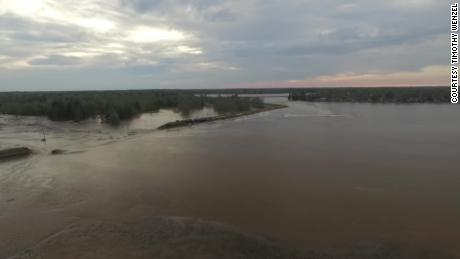 On Tuesday the Tittabawassee River violates the Edenville Dam.