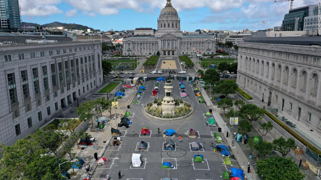 An aerial view of San Francisco's first temporary sanctioned tent encampment for the homeless on May 18, 2020 in San Francisco, California. The camp provides a sleeping area in a fenced-off space near City Hall with marked spots for tents that practice social distancing.