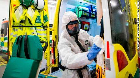 A healthcare professional cleans and disinfects an ambulance after leaving a patient at the Intensive Care Unit (ICU) at the Danderyd hospital near Stockholm on May 13.