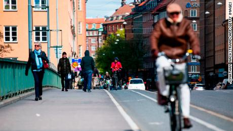 Pedestrians and cyclists cross a bridge in the heart of Stockholm on 11 May.