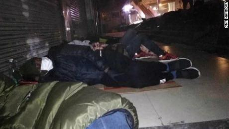 Africans sleep on the street in Guangzhou after being unable to find shelter.
