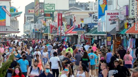 Some Americans take a vacation from social distances and officials fear future spikes in coronavirus cases