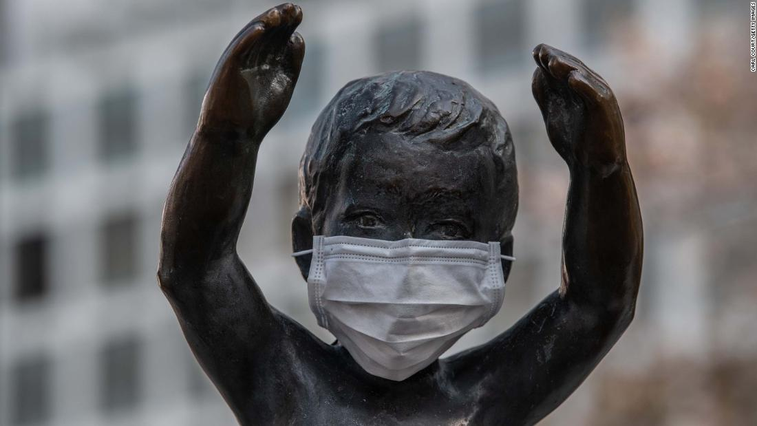 A statue of a small boy is pictured with a face mask on April 8, 2020 in Tokyo, Japan.