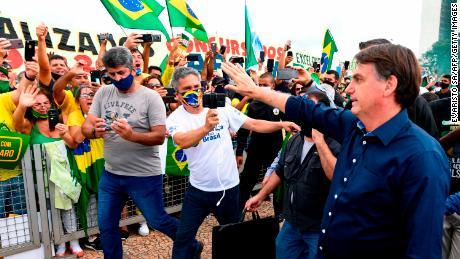 Brazilian President Jair Bolsonaro greets supporters on May 24.