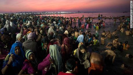 Hindus dive into Prayagraj, where the Ganges, Yamuna and Sarasvati rivers converge.