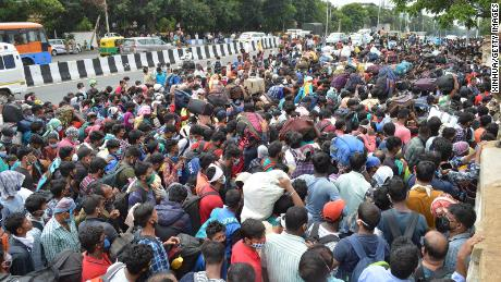 Migrant workers wait to board the buses during the coronavirus blockade in Bangalore on May 23, 2020.