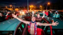 Fans rejoice as they watch the Czech First Division football game between FC Viktoria Plzen and AC Sparta Praha in a drive-in cinema in Plzen, the Czech Republic.
