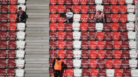 Fans of the DVTK home team await before the start of the Hungarian championship game against Mezokovesd.