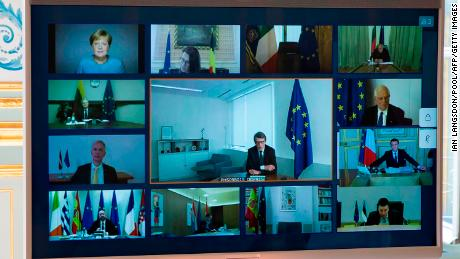 An image shows a screenshot of a videoconference between members of the European Council, seen at the Elysée Palace in Paris, on March 26, 2020, to discuss the coordination of EU efforts to tackle the covid-19 outbreak.