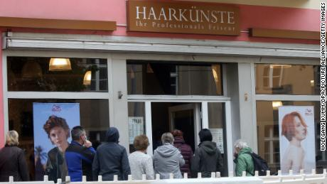 A line is formed in a salon in Berlin on Monday after the reopening of the hairdressers.