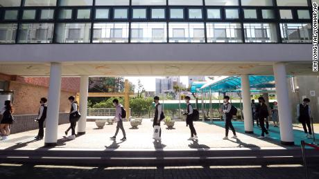 Senior students keep their social distances when they arrive at Hamwol High School in Ulsan, South Korea on Wednesday 20 May 2020.