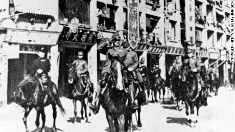 Japanese troops parade for the defeat of Hong Kong in 1941.