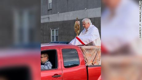 A priest went around the back of a pickup truck that blessed the people of Philadelphia