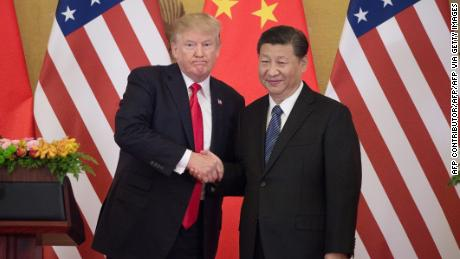 United States President Donald Trump (L) shakes hands with President of China Xi Jinping during a press conference at the Great Hall of the People in Beijing on November 9, 2017.