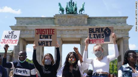 People participate in a demonstration against racism in front of the Brandenburg Gate in Berlin on Sunday.