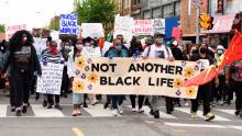 Protesters sing slogans during a demonstration in Toronto on May 30th.