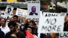 Protesters march on Queen Street in Auckland, New Zealand on Monday.