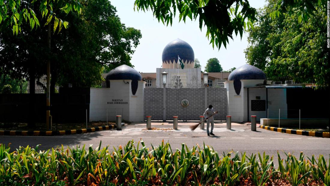A man sweeps in front of the main gate of the Pakistan High Commission in New Delhi on June 1, 2020.