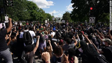 Protesters gather near the White House on Sunday.