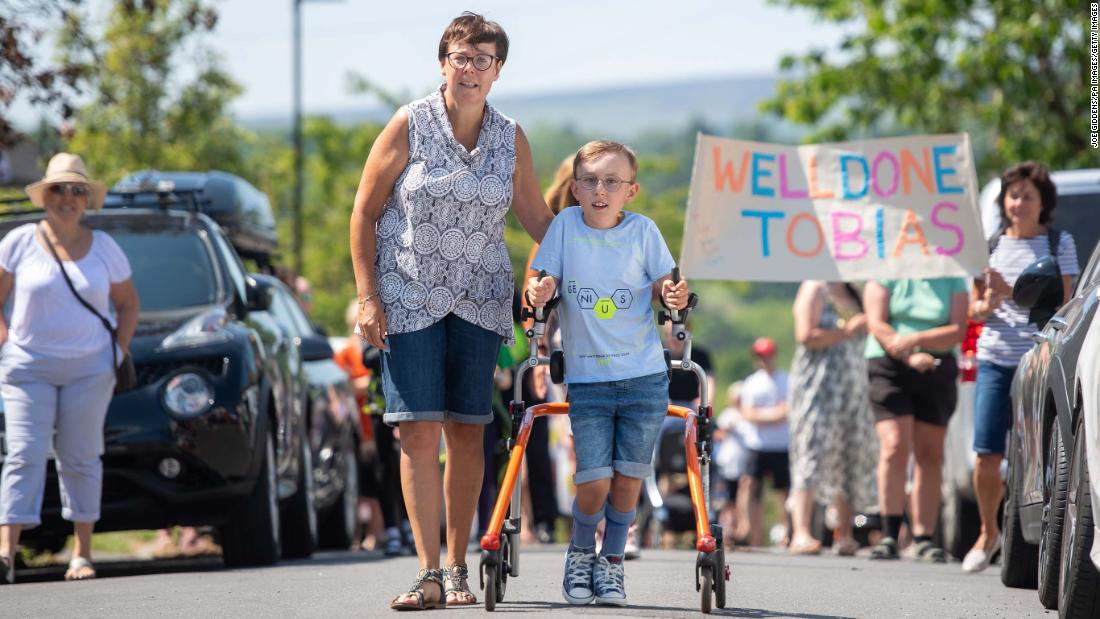 Tobias Weller, 9, who has a cerebral palsy, completes the charity marathon on his walker