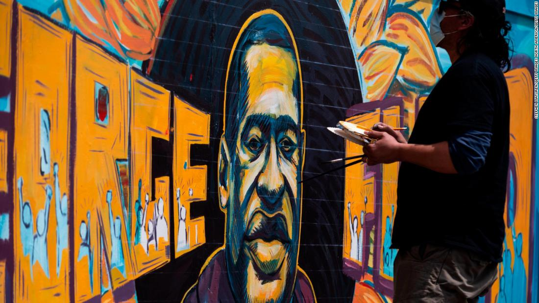 A group of artists paint a mural of George Floyd in Minneapolis, Minnesota on May 28.