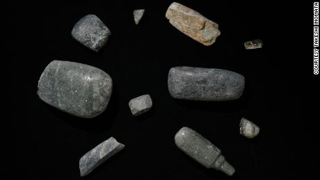 Axes excavated from the site, which date back to 1,000-700 BC. Other precious objects have also been found.