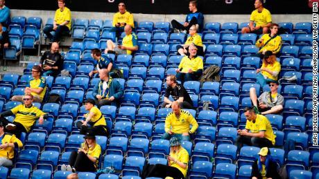 Spectators look on during the Danish Superliga match between Broendby and FC Copenhagen on June 21.