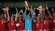 Bayern Munich lift the German Cup after beating Bayer Leverkusen 4-2.