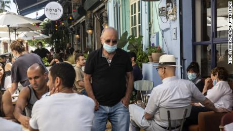 A man wearing a protective mask in a crowded restaurant in Jaffa, Israel, on May 29.