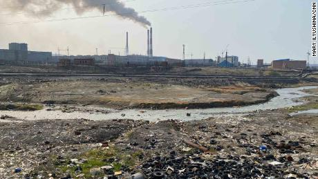 A dump on the river bank next to an pre-processing plant on the outskirts of Norilsk.