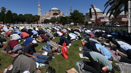 Men take part in Friday prayers outside Hagia Sophia in Istanbul on July 24, 2020.