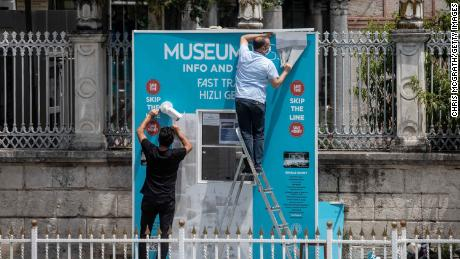 Workmen dismantle the Hagia Sophia Museum ticket booth on July 17, 2020 in Istanbul.