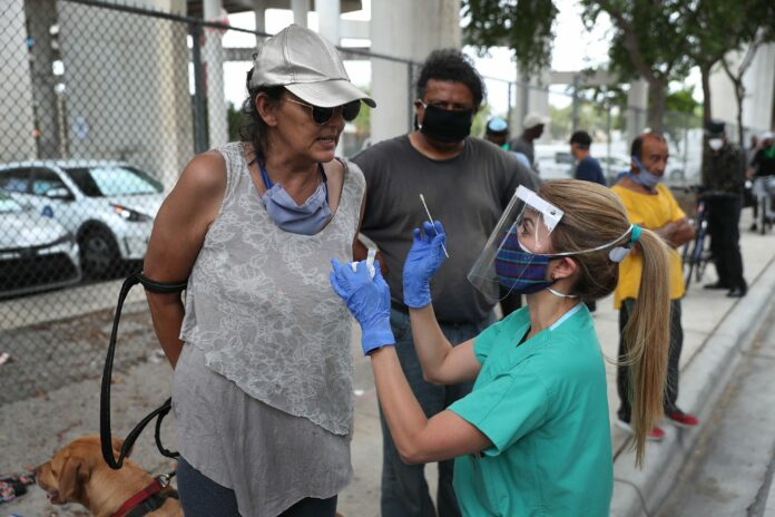 Florida reports more than 15,000 new cases, shattering record