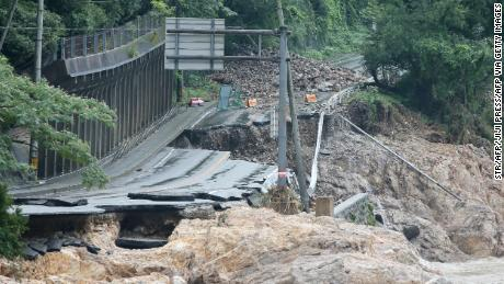 A road is destroyed following torrential rain near the Kuma river in Ashikita, Kumamoto prefecture, on July 6, 2020.