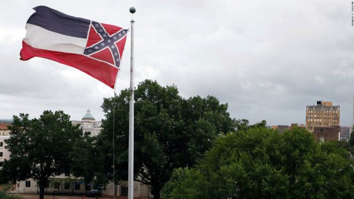 Mississippi governor signs bill to retire flag with Confederate emblem