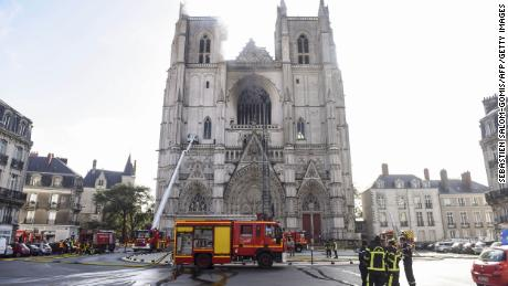 Firefighters work to put out a fire at the Saint-Pierre-et-Saint-Paul cathedral in Nantes.