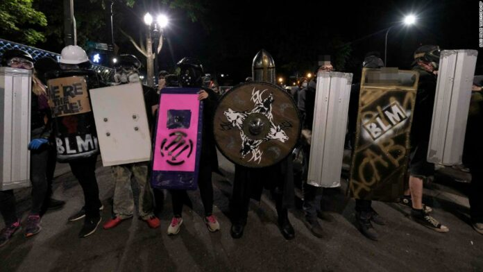 Portland protests: Several arrested after police say they blocked buildings and threw projectiles
