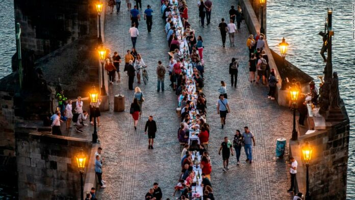 Prague celebrates end of coronavirus lockdown with mass dinner party at 1,600-foot table