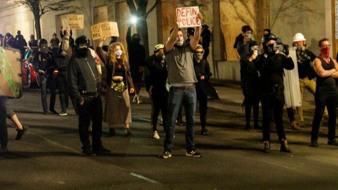 Protesters asked to leave or risk arrest after Portland Police Association office is set ablaze